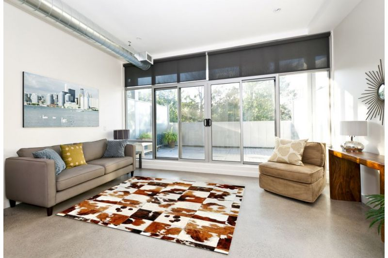 Exotic tricolor cowhide rug
