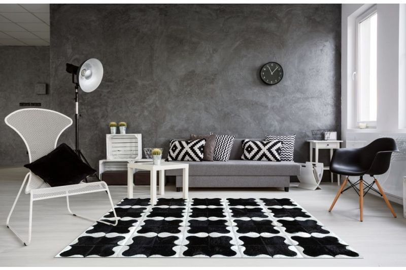 Black and white puzzle cowhide rug
