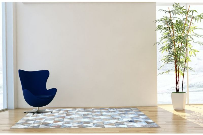 Grey, white and beige triangles cowhide rug