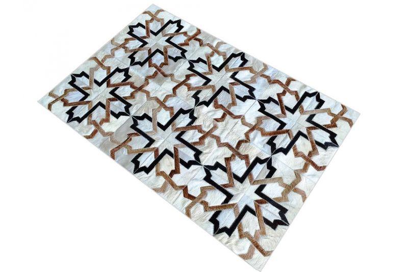 White, black and beige modern cowhide rug