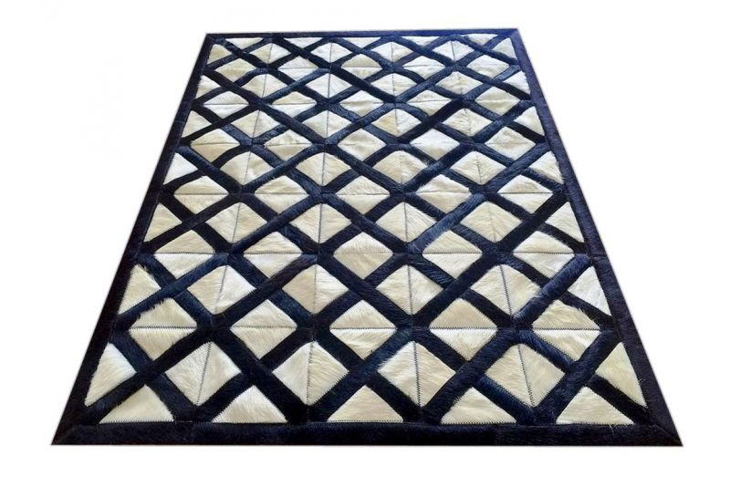 Black and beige crossed ways cowhide rug